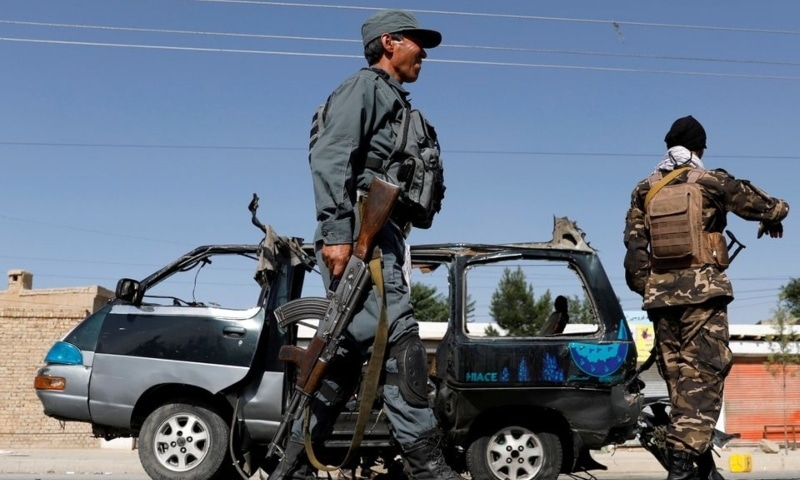 Afghan police officer inspects a damaged van after a blast in Kabul, Afghanistan, June 3. — Reuters