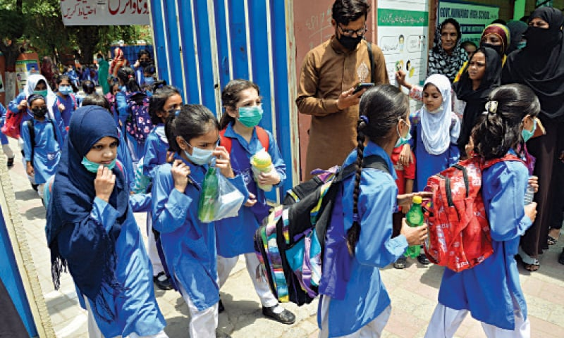 Students coming out of Govt Kinnaird High School at Boharwala Chowk after reopening of the educational institutions, which were closed due to Covid pandemic. — White Star