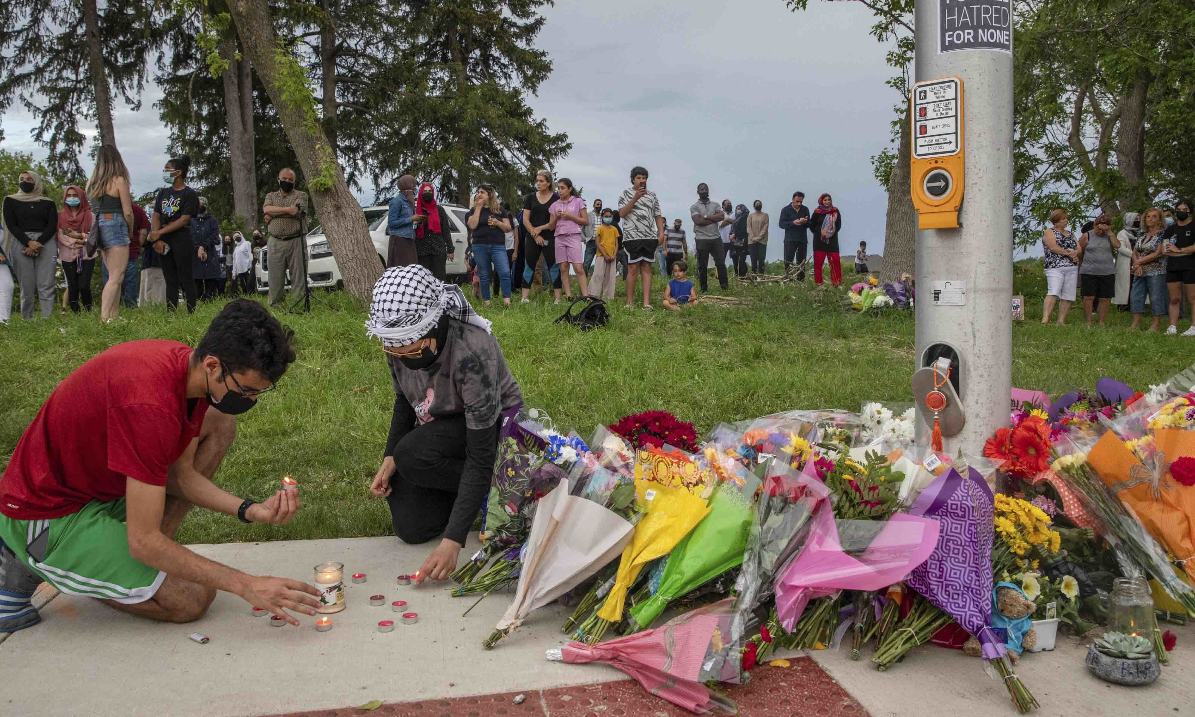 Abood, 18, left, and his sister Zeina Abdulhadi, 15, attend a memorial at the location where a family of five was hit by a driver, in London, Ontario. — AP