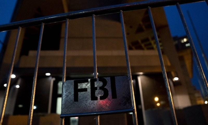Police barricades stand in front of the Federal Bureau of Investigation (FBI) headquarters on January 11. — AFP/File