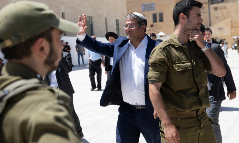 Israeli Knesset member Itamar Ben Gvir waves to soldiers after visiting the Western Wall, the holiest site where Jews can pray in the Old City of Jerusalem on Tuesday. — AP