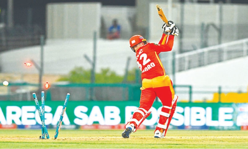ABU DHABI: Islamabad United opener Colin Munro is bowled by Lahore Qalandars' seamer James Faulkner (not in picture) during their PSL fixture on Wednesday.—Courtesy PCB