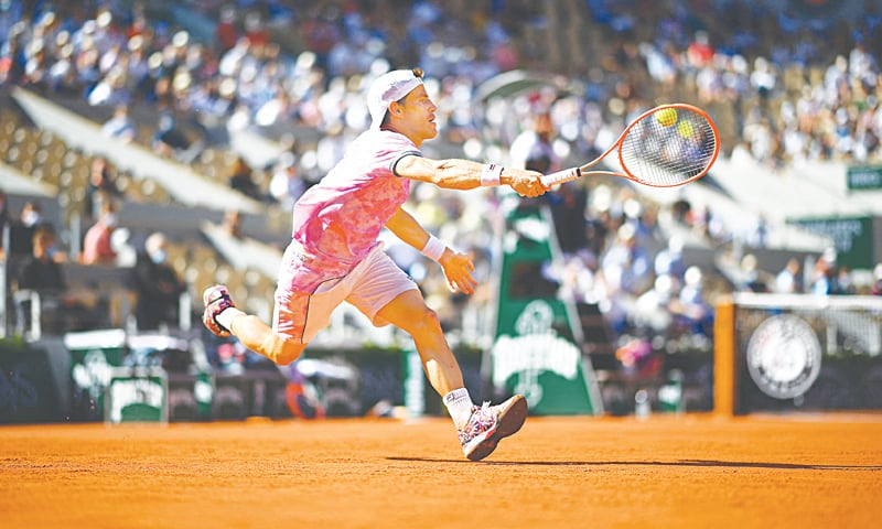 PARIS: Argentina's Diego Schwartzman hits a return to Rafael Nadal of Spain during their French Open quarter-final on Wednesday.—AFP