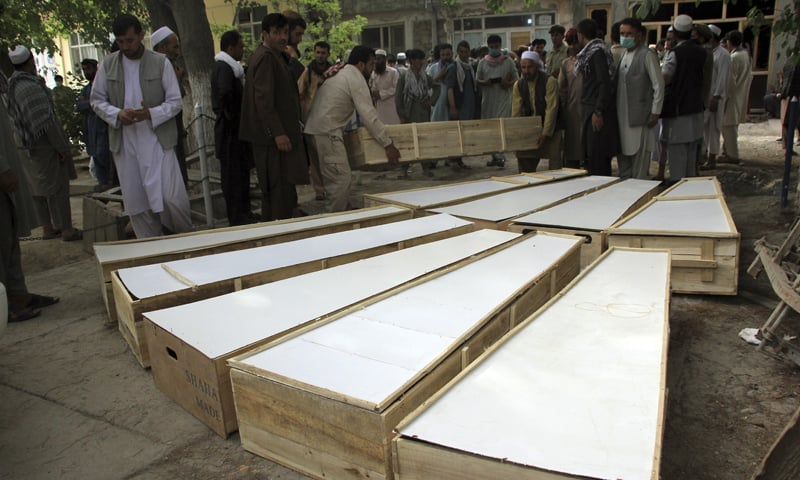 The coffins of the victims in Tuesday's attack are placed on the ground at a hospital in northern Baghlan province, Afghanistan. — AP