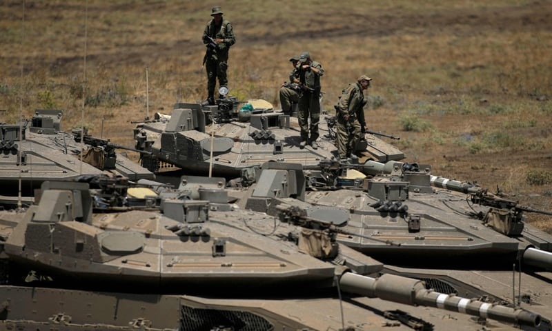 A picture shows an Israel military drill near Kibbutz Merom Golan in the Israeli-annexed Golan Heights. — AFP