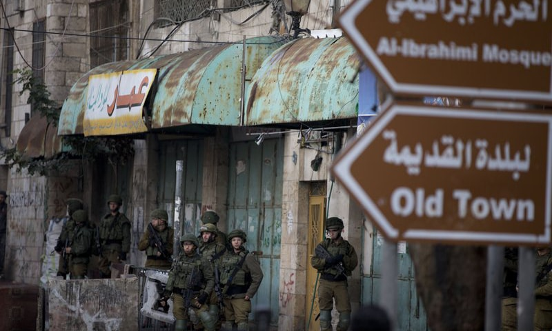 This file photo shows Israeli soldiers taking positions during a protest by Palestinians in the West Bank. — AP