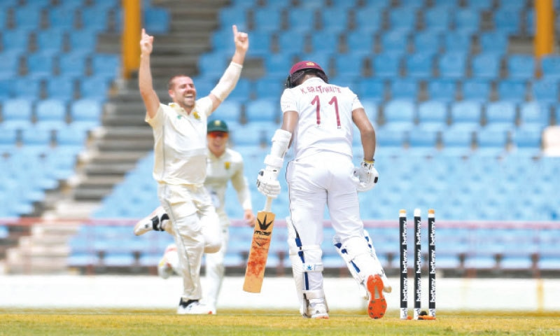 GROS ISLET: South African paceman Anrich Nortje celebrates after cleaning up West Indies opener Kraigg Brathwaite during the first Test at the Darren Sammy Cricket Ground on Thursday.—AFP