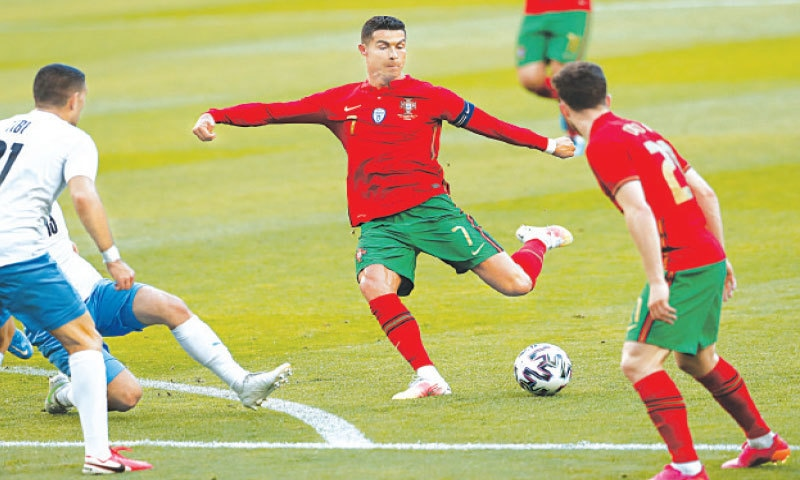 LISBON: Portugal's Cristiano Ronaldo shoots during the Euro 2020 warm-up against Israel at the Jose Alvalade Stadium on Wednesday. Ronaldo scored to lead Portugal to a 4-0 win in their final warm-up match before defending their European Championship title. Ronaldo scored in the 44th minute to take his international tally to 104 goals. He will enter Euro 2020 five goals away from matching former Iran striker Ali Daei's record as the all-time top scorer in international football. Bruno Fernandes scored twice while Joao Cancelo also scored for Portugal.—AP