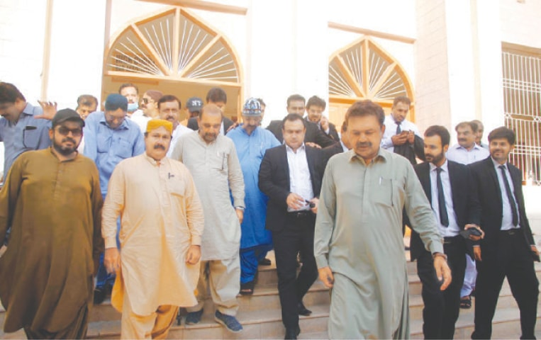 Syed Jalal Mehmood Shah and other SAC leaders leave the Sindh High Court building in Hyderabad after getting bail on Thursday.—PPI