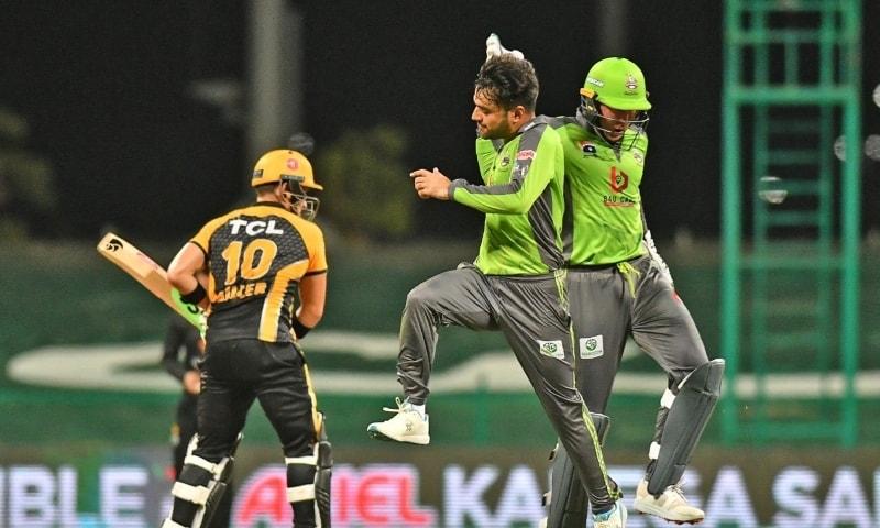 LAHORE Qalandars' spinner Rashid Khan celebrates with Ben Dunk after a dismissal during the HBL PSL match against Peshawar Zalmi at the Sheikh Zayed Stadium on Thursday.