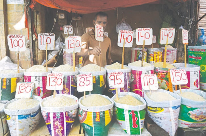 Different varieties of rice on sale in a city market on Thursday.—AFP