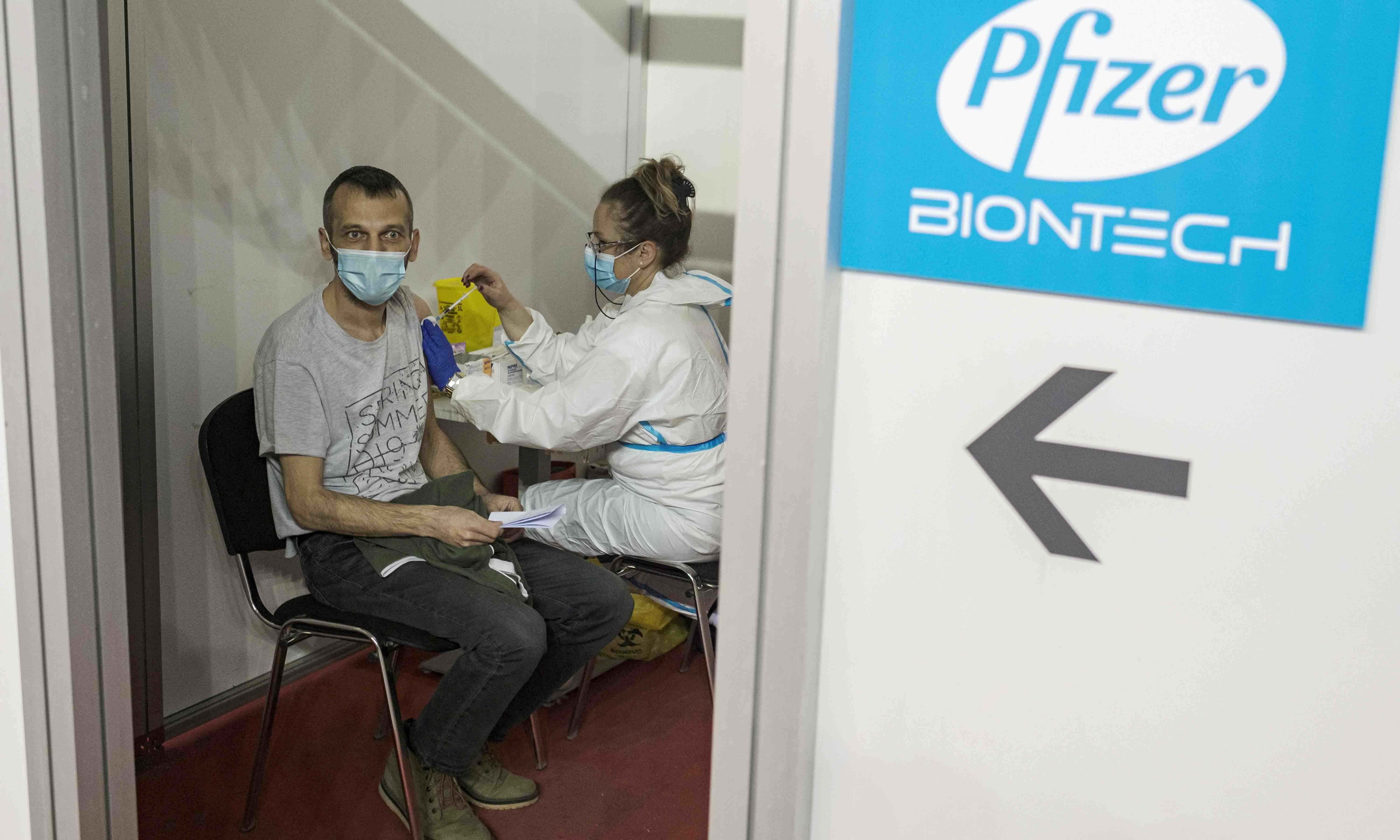 A man receives a second dose of the Pfizer-BioNTech vaccine against the coronavirus disease in Belgrade, Serbia, on April 13. — Reuters