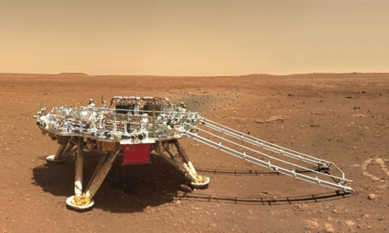 In this image released by the China National Space Administration on June 11, 2021, the landing platform with a Chinese national flag and outlines of the mascots for the 2022 Beijing Winter Olympics and Paralympics on Mars is seen from the rover Zhurong. — AP