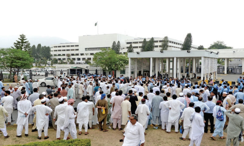 Pak Secretariat employees protest against, what they called, insufficient increase in their salaries outside the Parliament House in Islamabad on Friday. — Photo by Mohammad Asim