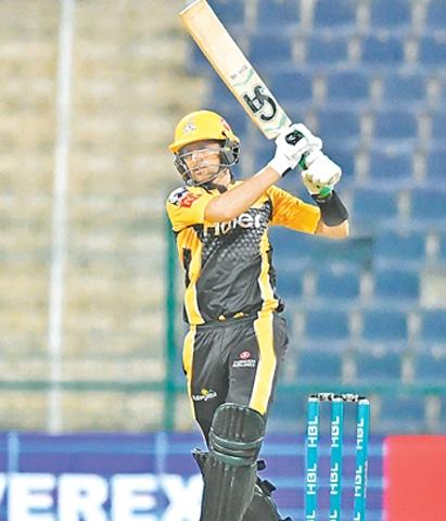 ABU DHABI: Peshawar Zalmi batsman Shoaib Malik plays a shot during the PSL match against Lahore Qalandars.—Courtesy PSL