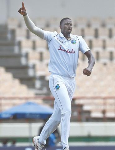 WEST INDIES paceman Jason Holder celebrates after dismissing South African batsman Rassie van der Dussen during the first Test at the Darren Sammy Cricket Ground on Friday.—AFP