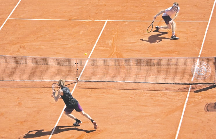 PARIS: Germany's Alexander Zverev (L) and Stefanos Tsitsipas of Greece in action during their semi-final at the French Open on Friday.—AP