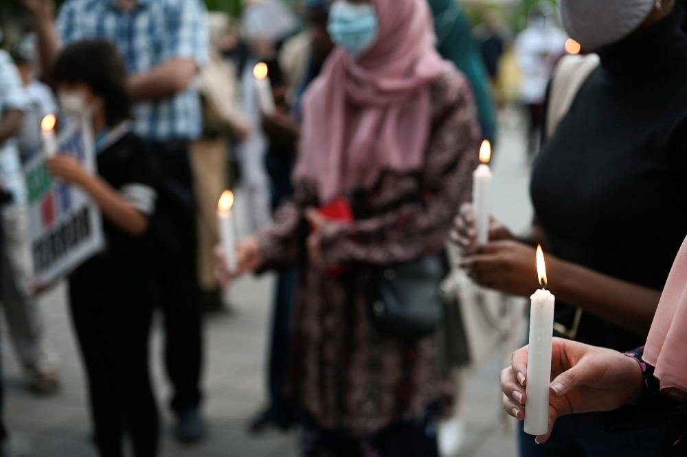 People hold candles during a vigil in memory of a Muslim family that was killed in London, Ontario in what police describe as a hate-motivated attack, in Montreal, Quebec, on June 11. — Reuters