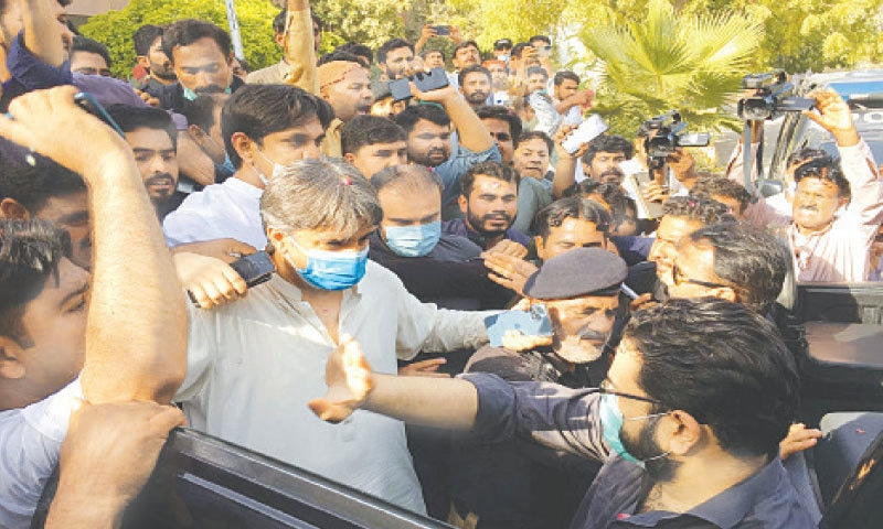 MPA Farrukh Shah being taken into custody outside court in Sukkur on Saturday.—PPI