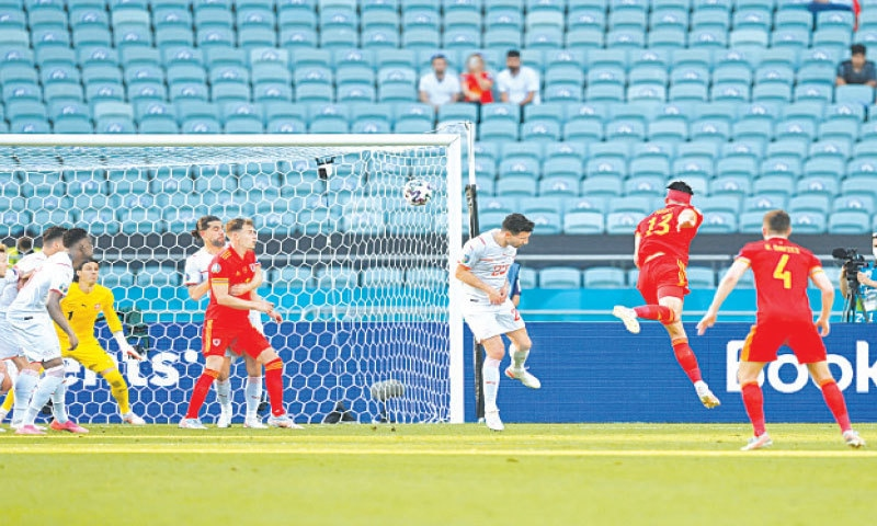 BAKU: Wales' Kieffer Moore (Second-R) heads the ball to score the equaliser against Switzerland during their Euro Group 'A' fixture at the Olympic Stadium on Saturday.—AFP