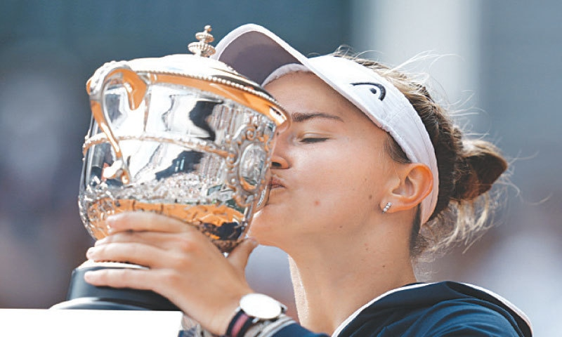 CZECH Republic's Barbora Krejcikova kisses the French Open trophy after defeating Russia's Anastasia Pavlyuchenkova in their women's singles final at the Roland Garros on Saturday. — AP