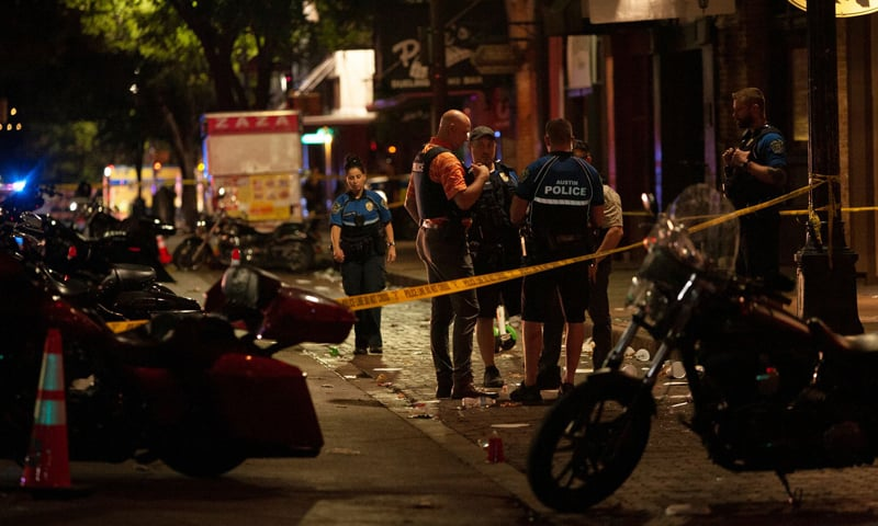 Police investigate the scene of a mass shooting in the Sixth Street entertainment district area of Austin, Texas. — Reuters