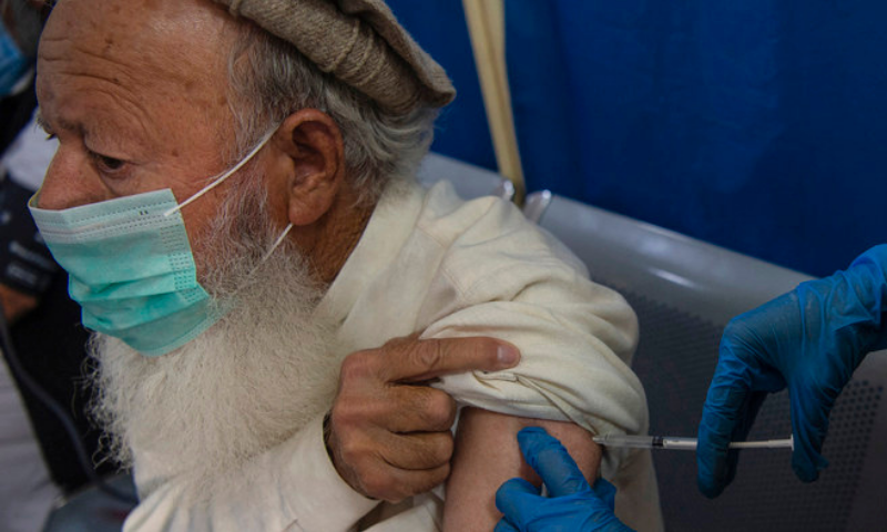 A senior citizen receives a dose of a Covid-19 vaccine at a vaccination centre in Peshawar. — AFP/File