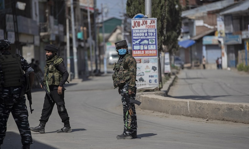 Indian paramilitary soldiers stand guard near the site of the shootout at Sopore, 55 kilometers north of Srinagar in India-occupied Kashmir. — AP