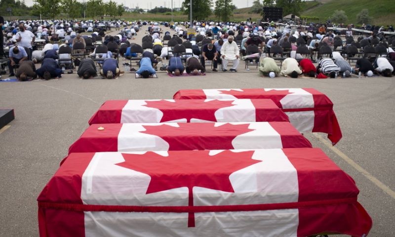 Mourners and supporters gather for a public funeral for members of the Afzaal family at the Islamic Centre of Southwest Ontario on Saturday. — AFP