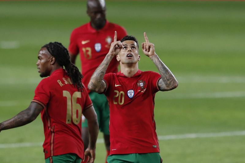 Portugal's Joao Cancelo celebrates after scoring his side's third goal during the international friendly football match between Portugal and Israel at the Alvalade stadium in Lisbon, June 9. — AP