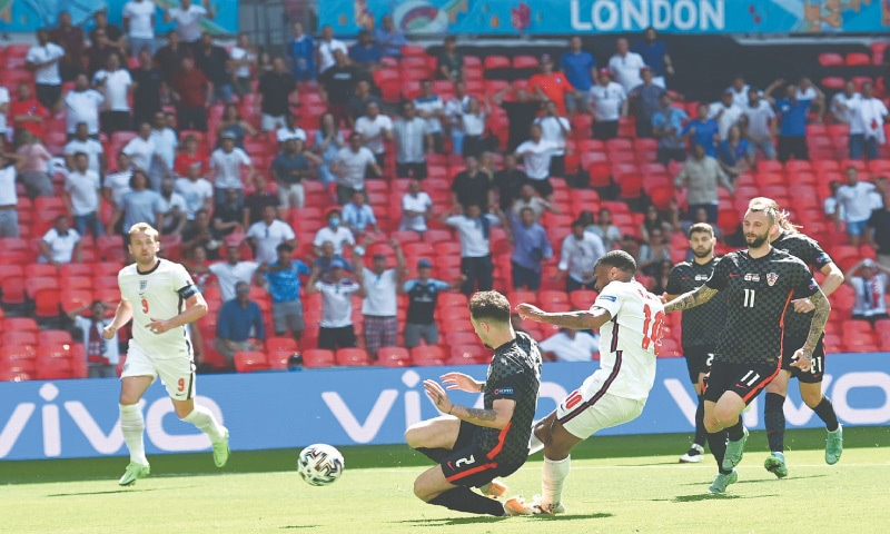 LONDON: England's Raheem Sterling (C) scores during the Group 'D' against Croatia at Wembley on Sunday.—AP