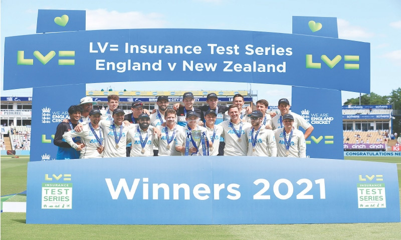 NEW ZEALAND players celebrate with the trophy after winning the Test series against England at Edgbaston on Sunday.—AFP