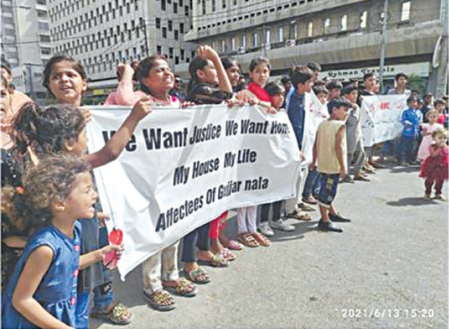 CHILDREN hold protest outside the Karachi Press Club on Sunday.—Photo by the author