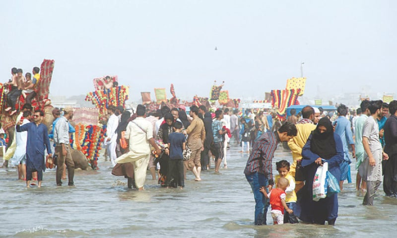KARACHI: People enjoy the weekly holiday at Sea View on Sunday, taking advantage of the easing of restrictions with the decrease in Covid cases .—Online