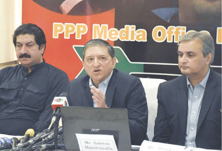 PPP Senator and former deputy chairman of Senate Saleem Mandviwala briefs the media on the impact of the federal budget on people at Sindh House in Islamabad on Sunday.—Online