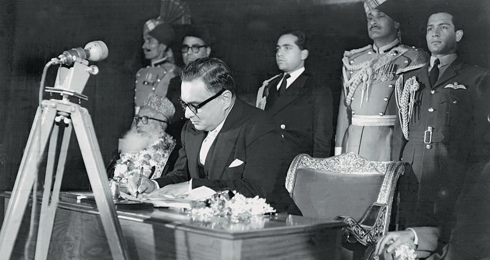 Governor General Iskander Mirza signing his assent on the 1956 Constitution Bill at a ceremony held on March 2, 1956, in Karachi. — The Press Information Department, Ministry of Information, Broadcasting & National Heritage, Islamabad