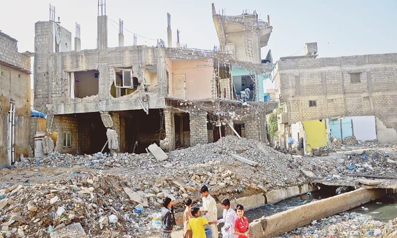 The demolition was the outcome of a Supreme Court order after [last year's devastating rains][2] that inundated Karachi, with storm-water drains resembling raging rivers. — White Star/File