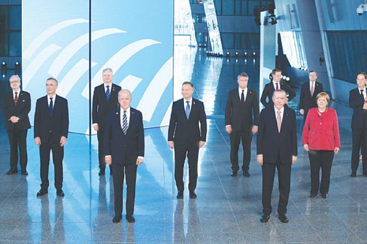 NATO heads of states and governments pose for a photo at the alliance's headquarters.—Reuters