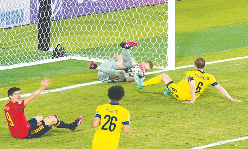 SEVILLA: Sweden goalkeeper Robin Olsen makes a save during the Euro 2020 Group E match against Spain at the La Cartuja Stadium.—AFP