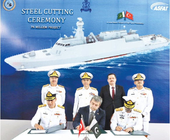 KARACHI: Officials of Pakistan Navy and Turkey sign the milestone certificate during the steel-cutting ceremony of PN corvette/ship here on Tuesday.—PPI
