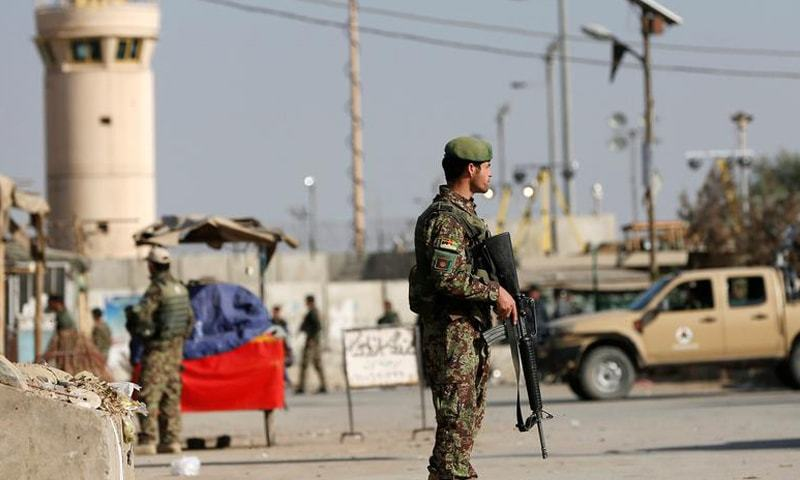 Afghan National Army (ANA) soldiers keep watch outside the Bagram Airfield entrance gate, after an explosion at the NATO air base, north of Kabul, Afghanistan November 12, 2016. Reuters/File