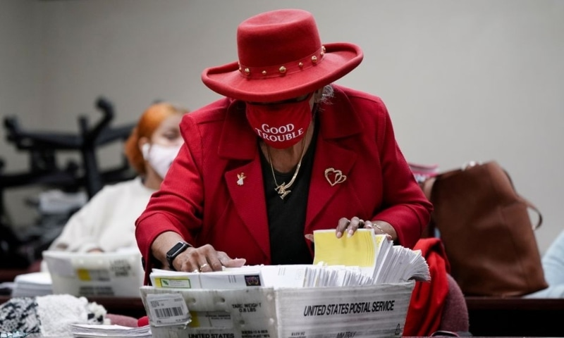 A DeKalb County election worker wearing a 'Good Trouble' facemask sorts empty absentee ballot envelopes following the US Senate runoff elections in Decatur, Georgia, US, January 6. — Reuters/File