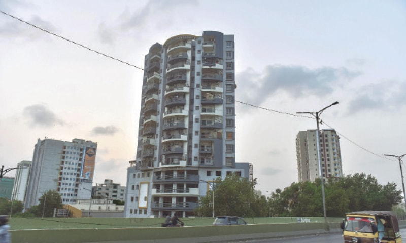 A view of the 15-storey Nasla Tower off Shahrah-i-Quaideen on Wednesday, which the apex court has ordered to be demolished. —Fahim Siddiqi/White Star