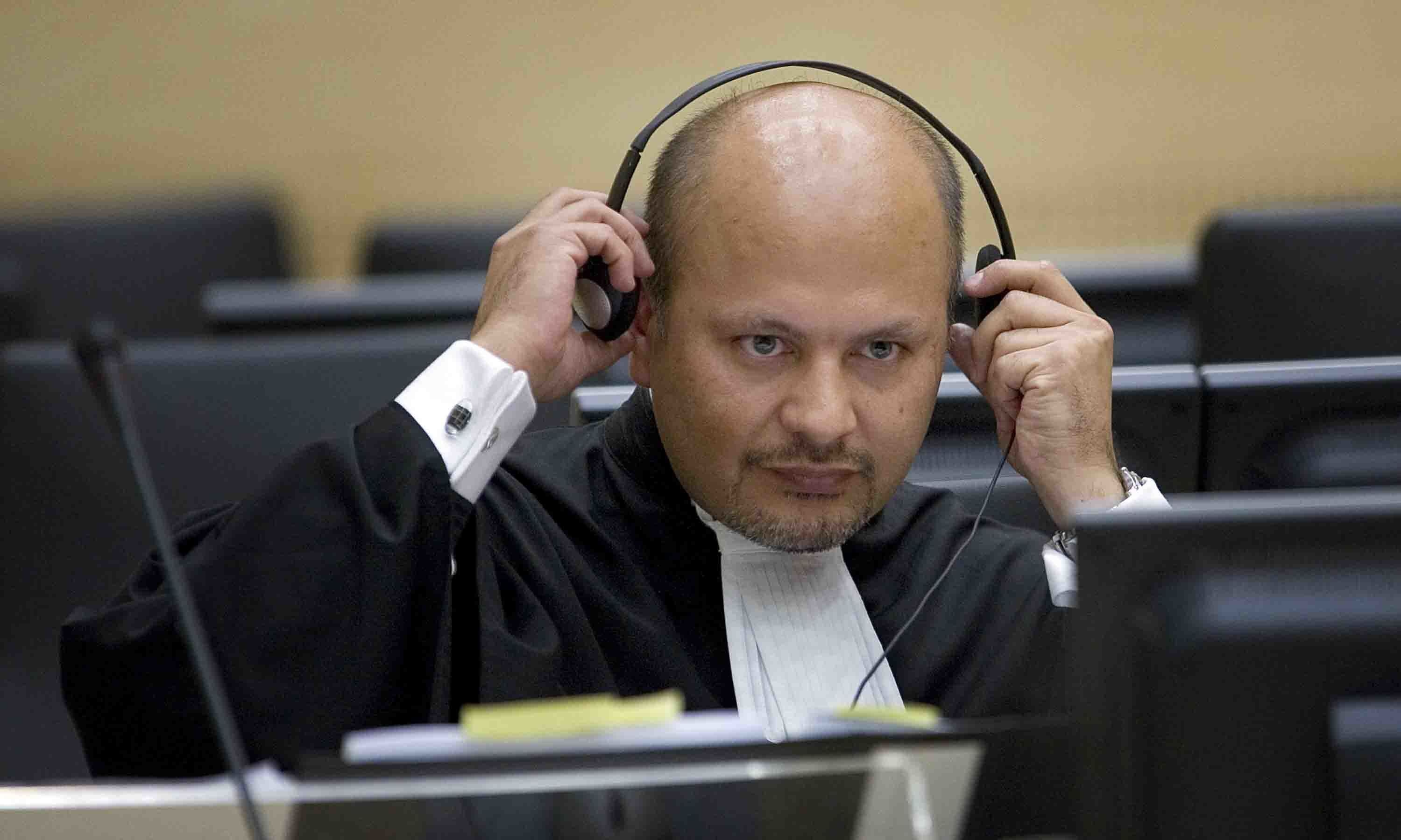 In this file photo, lawyer Karim Khan adjust his headphones in the courtroom of the Special Court for Sierra Leone in The Hague, the Netherlands. — AP