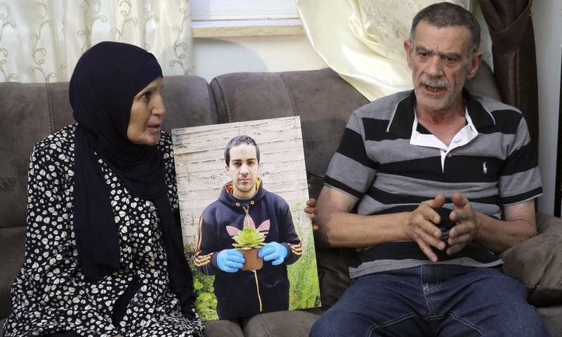 Parents of Eyah Hallaq talk during an interview in Jerusalem on June 3, 2020. — File/AP