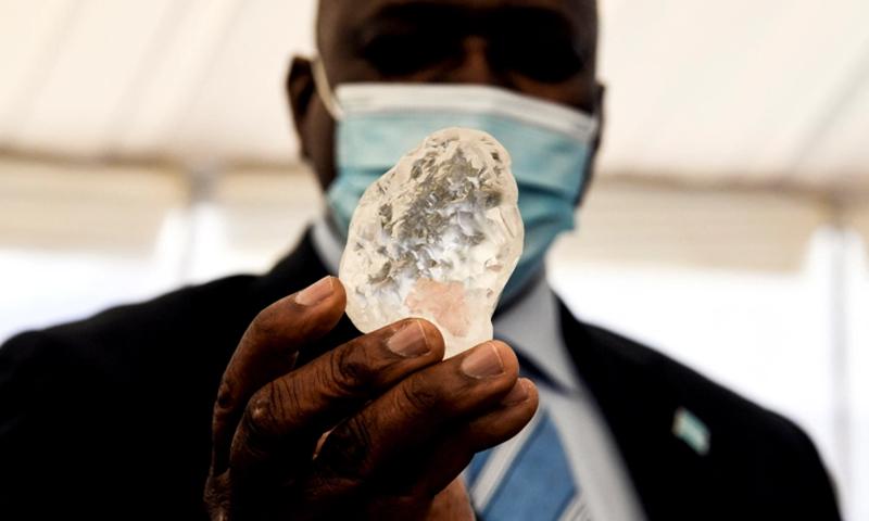 President Mokgweetsi Masisi holds the precious stone in Gaborone. — Photo by AFP