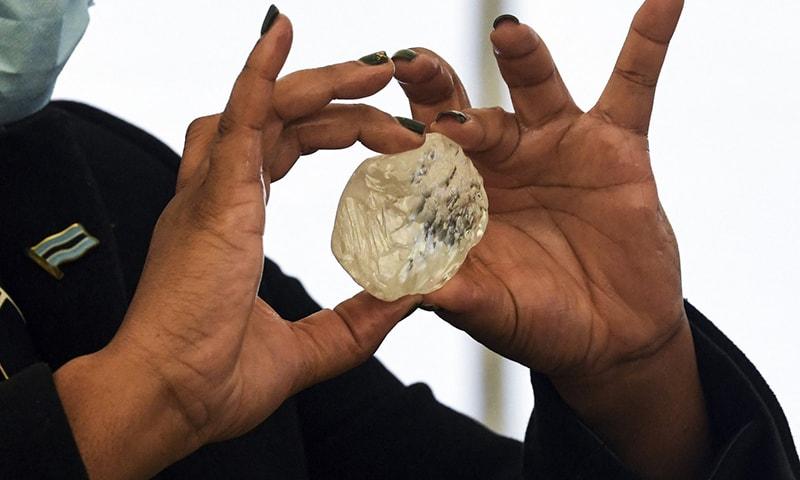 A Botswana member of cabinet holds a gem diamond in Gaborone, Botswana, on June 16, 2021. — AFP