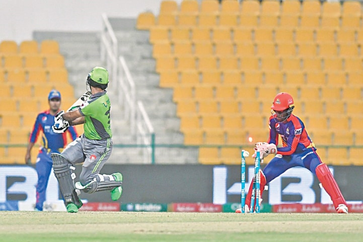 ABU DHABI: Lahore Qalandars' opener Fakhar Zaman is cleaned up by Karachi Kings skipper Imad Wasim during their HBL Pakistan Super League match at the Sheikh Zayed Stadium on Thursday night.—Courtesy PCB