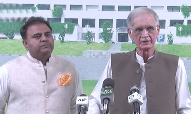 Minister for Information and Broadcasting Chaudhry Fawad Hussain and Defence Minister Pervaiz Khattak speak to the media. — DawnNewsTV