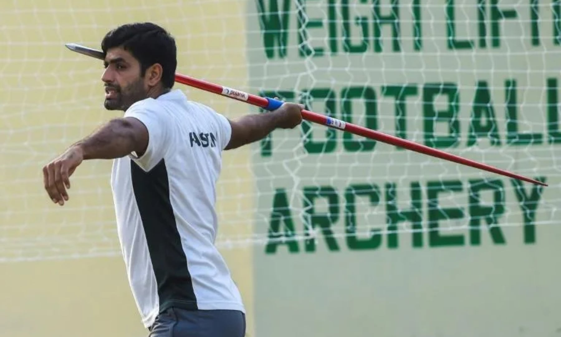 Arshad Nadeem practices the javelin throw during a training session in Lahore, June 2, 2021. — AFP